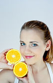 Beautiful girl with oranges dv — Stock Photo