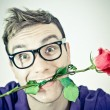 Crazy romantic man with a rose — Stock Photo