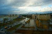Autumn cityscape through glass beads — Stock Photo