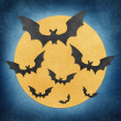 Royalty-Free Stock Photo: Halloween bat and full moon recycled papercraft background