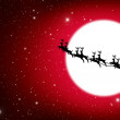 Santa Claus On Sledge With Deer And yellow Moon — Stock Photo #7104416