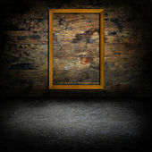 Picture frames on wood wall — Stock Photo