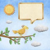 Bird recycled papercraft stick on grunge paper background — Stock Photo