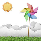 Windmill on grass recycled papercraft background — Stok fotoğraf
