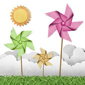 Windmill on grass recycled papercraft background — Stock Photo
