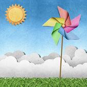 草の上の風車リサイクル ペーパー クラフトの背景 — ストック写真