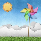 Windmühle auf gras recycling papercraft-hintergrund — Stockfoto