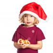 Happy girl in Santa hat with Christmas balls on white background — Stock Photo