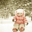 Stock Photo: Child playing at snowballs