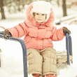 Baby playing on snow in winter — Stock Photo #6892351