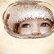 Child look out of hole — Stock Photo #6892354
