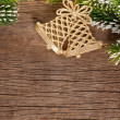 Christmas border from branch and bells — Stock Photo