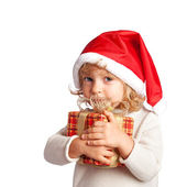 Child holding gift — Stock Photo