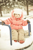 Baby playing on snow in winter — Stock Photo