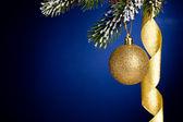 Gold Christmas balls and ribbon — Stock Photo