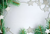Christmas frame from branch and stars — Stock Photo