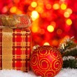 Christmas gift and decorations in snow — Stock Photo