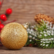 Christmas tree decorations on wood — Stock Photo