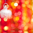 Decoration against Christmas lights — Stock Photo