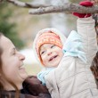 Baby and mother in winter — Stock Photo