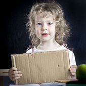 Schoolchild with paper blank — Stock Photo