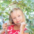 Portrait of the beautiful blonde little girl on nature — Стоковая фотография