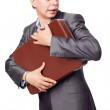 Young businessman embraces portfolio isolated on white backgrou — Stock Photo