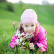 Little girl with branch of flowers — Stock Photo