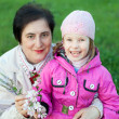 Mature woman and funny little girl — Stock Photo