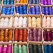 Colored threads for sewing machine in box — Stock Photo