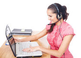 Young beautiful call center female operator — Stock Photo