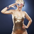 Blond model in gold swimwear and American inspired accessories. — Stock Photo