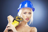 Portrait of a blonde model with angle grinder and helmet — Stock Photo