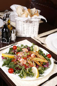Beautiful and exotic salad with shrimps, lemon, cherry tomatoes — Stock Photo