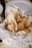 Close-up with elegant white basket with fresh bread. — Stock Photo