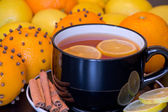Warm drink with orange and lemon — Stock Photo