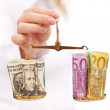 Evaluating currency rate risk — Stock Photo