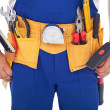 Handy man with lots of tools — Stock Photo