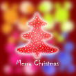 Christmas greeting card with tree and blurry lights - Stock Photo