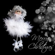 Fluffy angel and christmas lights — Stock Photo