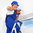 Worker drilling hole in wall — Stock Photo
