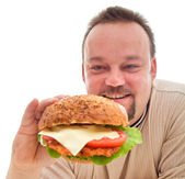 Food addiction - man in denial phase — Stock Photo