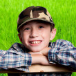 Smiling boy on field background — Stock Photo