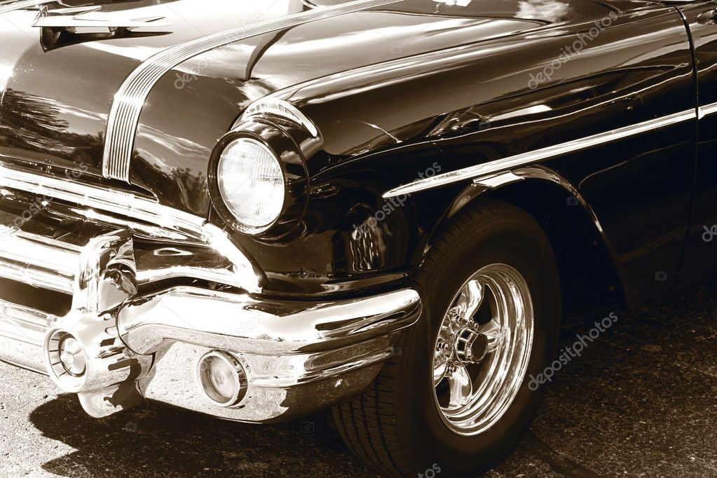 Classic car front end in sepia color — Stock Photo #7605067