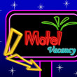 Motel sign board - Stock Photo