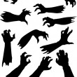 Stock Vector: Scary zombie hands silhouettes set.