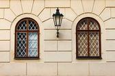 Renaissance windows with iron street lamp — Stock Photo