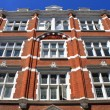 British red brick building - Foto Stock