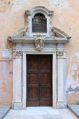 Front door of a medieval church — Stock Photo