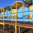 Bathing boxes on the beach — Stock Photo